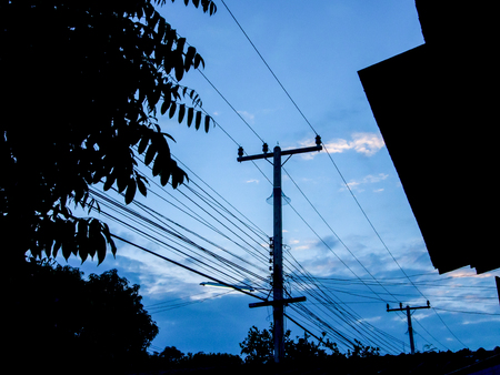 Electricity poles in the small village in the evening, near sunset.