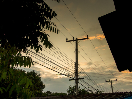 telephone pole: Electricity poles in the small village in the evening, near sunset.