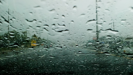 Heavy rain on the freeway bridge.