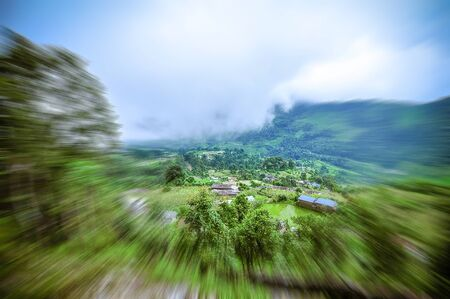 Hiking activities, forest views and bright mountain sky. Abstract blur zoom.