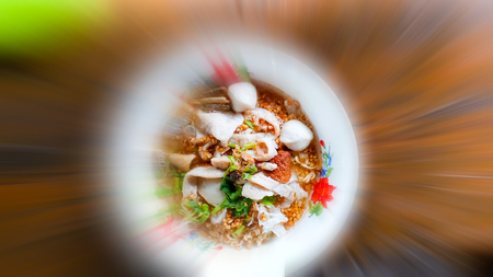 Instant Noodles Tom Yum Noodles with fish balls and sponges on wooden boards. Stock Photo