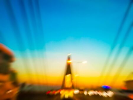 On the expressway, there are colorful lights and evening sky. With lots of cars and trucks. Blurred abstract images