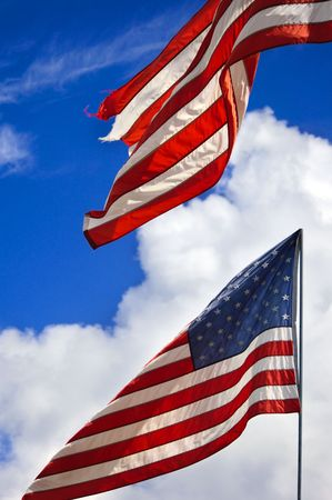 american flag in the wind on a blue sky Stock Photo - 5908028