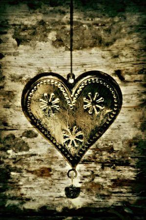 gold metal heart on vintage background photo
