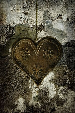 gold metal heart on vintage background photo