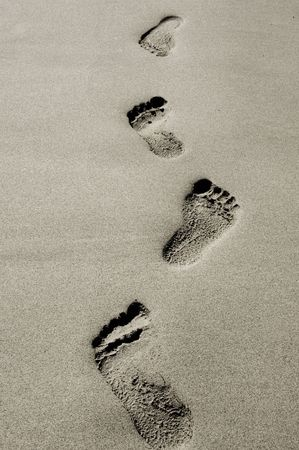 footprints in the sand black and white  photo