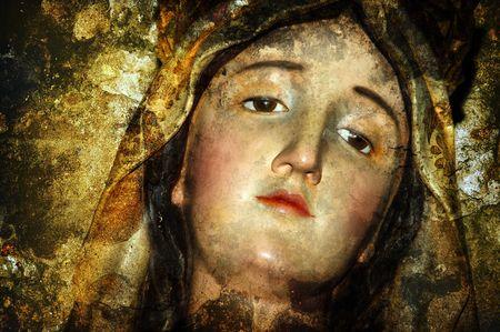 figure of virgin mary on vintage background photo