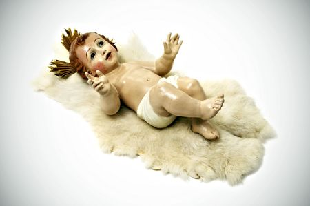figure of baby jesus on white background photo