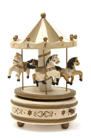 carrousel: antique wooden carousel on a white background Stock Photo