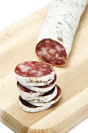 red spanish salami on a white background photo