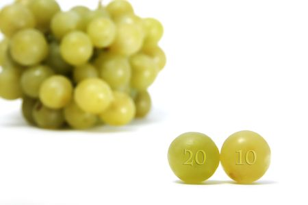 2010 writing on grapes on a white background Stock Photo