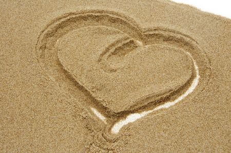 heart drawn in sand at the beach photo