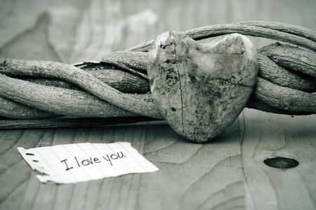 heart of stone on a wooden table Stock Photo - 6183548