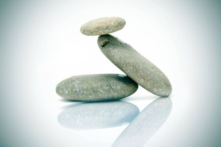 a zen stones on a white background photo