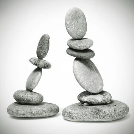 inukshuk: a zen stones on a white background Stock Photo