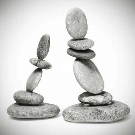 thalasso: un pierres zen sur un fond blanc