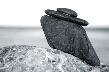 strength therapy: a zen stones background white and black  Stock Photo