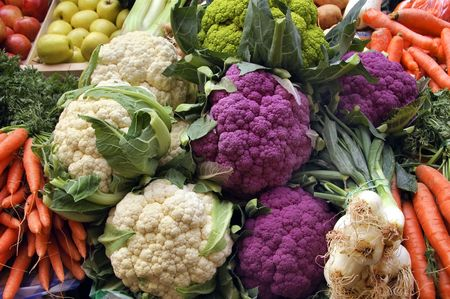 produces:  cabbage,cauliflower,onions,carrots,apples and broccoli  Stock Photo