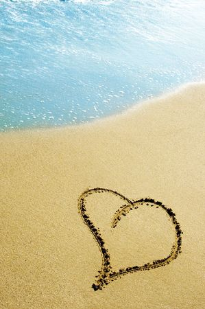 evoking: hearts drawn on the sand of the beach