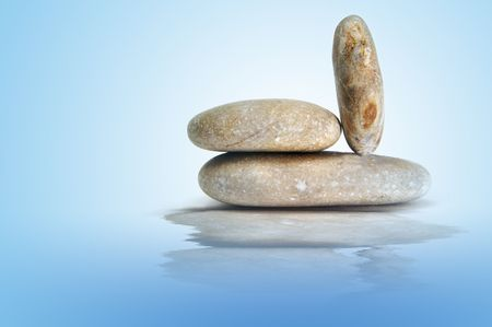 a zen stones on a blue background Stock Photo - 6336920