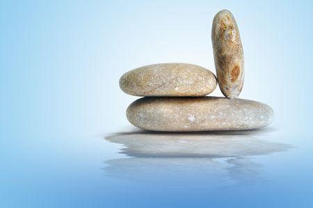 karesansui: a zen stones on a blue background Stock Photo