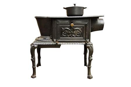 an ancient iron kitchen stove on a white background photo