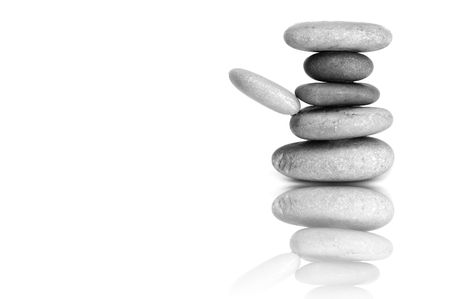 inukshuk: a zen stones background white and black  Stock Photo