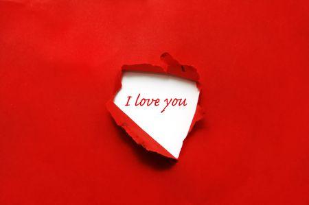 pasion: I love you escrita en papel con un agujero Foto de archivo