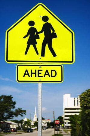 crosswalk: an school crosswalk ahead traffic sign in a road