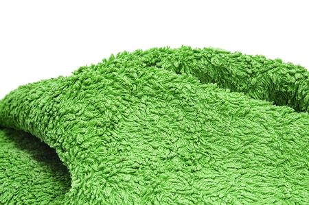 a green towel on a white background photo