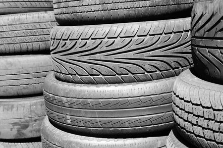 pneumatic tyres: close-up of a pile of pneumatic tyres background Stock Photo