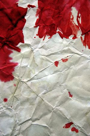 background made with blood-stained crumpled paper photo