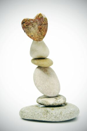 zen stones  with heart on a white background Stock Photo - 6416903