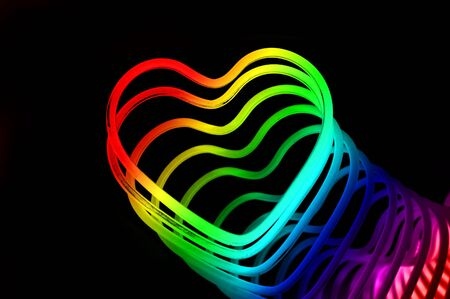 eclecticism: colored hearts on a black background