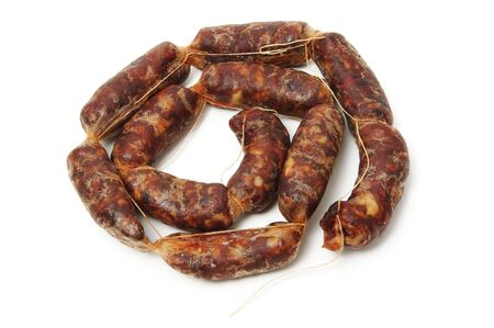 red spanish chorizo on a white background photo
