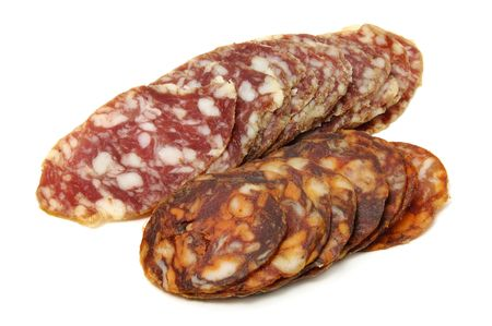 spanish chorizo and salami slices on a white background photo