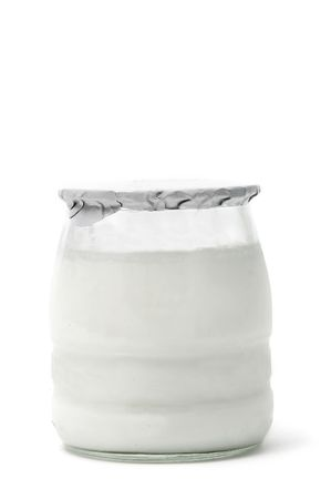 a plain yogurt in a glass jar isolated on a white background photo