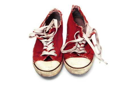 a pair of red sneakers isolated on a white background Stock Photo - 6450136