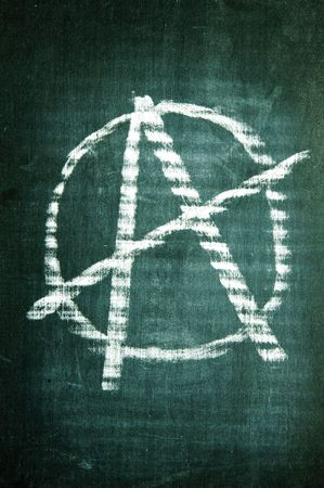 anarchism: anarchism sign written with a chalk on a blackboard