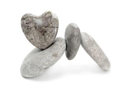 karesansui:  zen stones  with heart on a white background