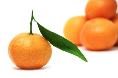 clementines: isolated tangerine with leaves on a white background