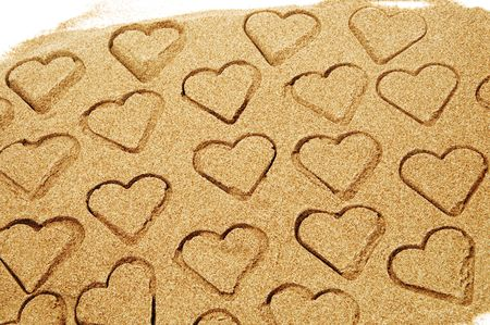 hearts drawn on the sand  photo