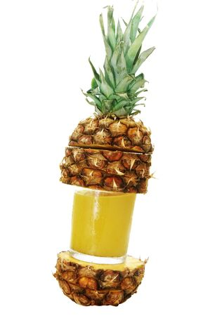 juice squeezer: a glass of freshly squeezed pineapple juice and pineapple slices