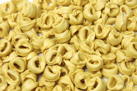 a pile of tortellini isolated on a white background Stock Photo - 7086923