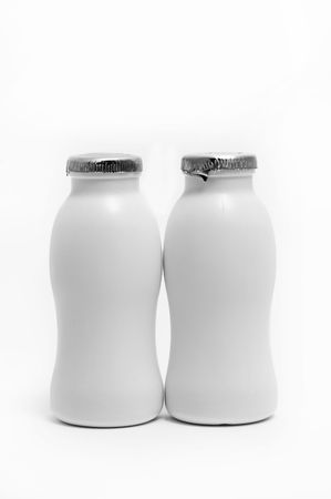 casein: two white bottles isolated on a white background