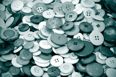 a pile of buttons of different shapes and sizes in black and white photo