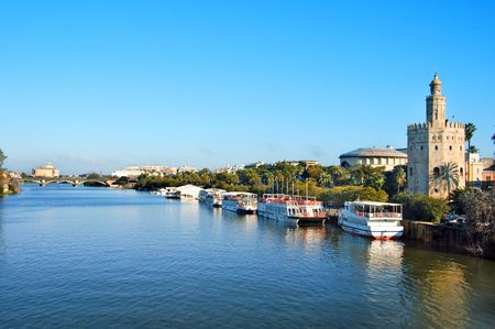 seville: A view of the Guadalquivir River and the Torre del Oro, in Seville, Spain