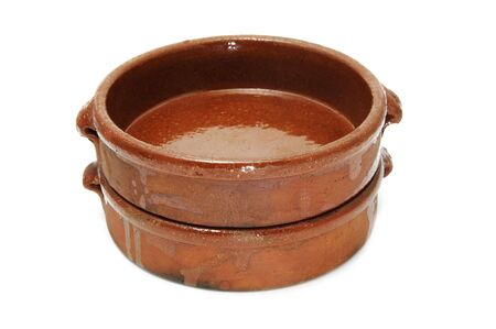 cazuela: two earthenware casseroles isolated on a white background