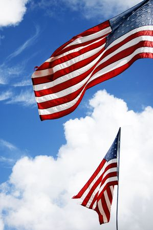 american flag in the wind on a blue sky  Stock Photo - 6686880
