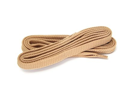 shoelaces: a pair of beige shoelaces isolated on a white background Stock Photo